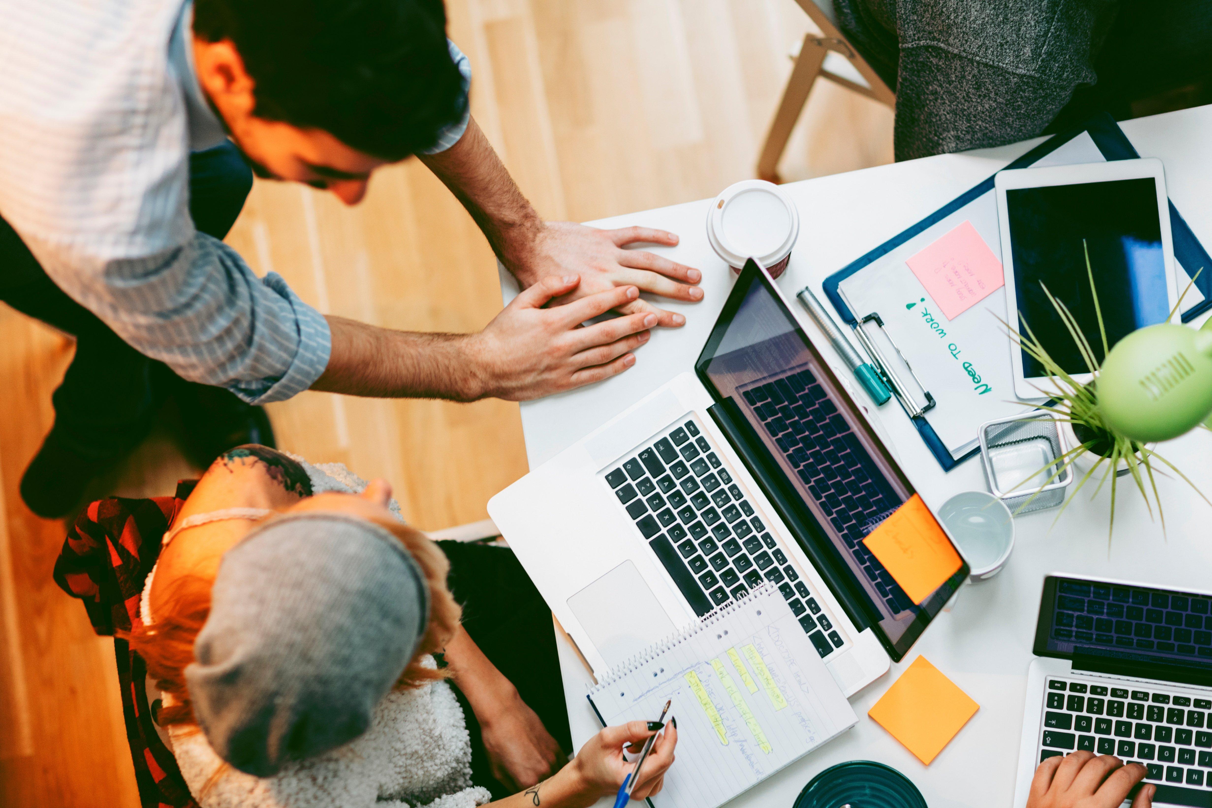 Development_Team_Cooperating_In_Their_Office.jpg